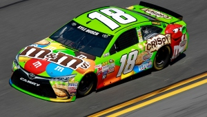 DAYTONA BEACH, FL - FEBRUARY 15: Kyle Busch, driver of the #18 M&M's Crispy Toyota, races during qualifying for the 57th Annual Daytona 500 at Daytona International Speedway on February 15, 2015 in Daytona Beach, Florida.  (Photo by Brian Lawdermilk/Getty Images)