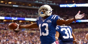 Indianapolis Colts wide receiver T.Y. Hilton celebrates his touchdown against the Seattle Seahawks during the second half of an NFL football game in Indianapolis, Sunday, Oct. 6, 2013. (AP Photo/Brent R. Smith)